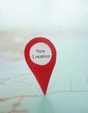 Map New Location. Red New Location locator on a map stock photo