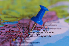 Map of New York with a blue pushpin stuck. Map of New York with a blue pushpin Stock Image