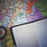 Map of new york. Compass and notepad for notes. Concept idea - travel to New York, a big city.  Royalty Free Stock Photos