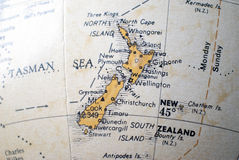 Map of New Zealand on a world globe Stock Photos