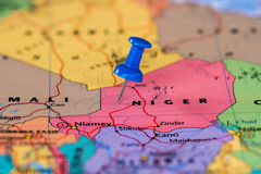 Map of Niger with a blue pushpin stuck Stock Photo
