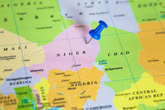 Map of Niger with a pushpin stuck. Map of Niger with a blue pushpin stuck Royalty Free Stock Images