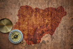 Map of nigeria on a old vintage crack paper. Background with compass royalty free stock photos