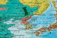 Map of North Korea. With a green pushpin stuck stock image