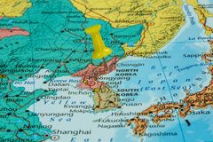 Map of North Korea. With a yellow pushpin stuck stock image