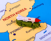 Map of North Korea with a military machine. With an intercontinental missile stock image