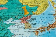 Map of North Korea. With a orange pushpin stuck royalty free stock photo