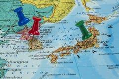 Map of North Korea, South Korea and Japan. With a pushpin stuck stock photos