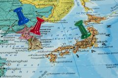 Map of North Korea, South Korea and Japan. With a pushpin stuck royalty free stock image