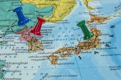 Map of North Korea, South Korea and Japan. With a pushpin stuck royalty free stock photo