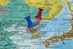 Map of North Korea and South Korea. With a pushpin stuck stock photos