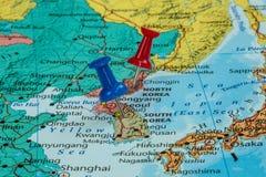 Map of North Korea and South Korea. With a pushpin stuck stock photo