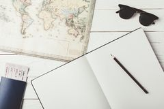 Map with notebook and pencil Royalty Free Stock Photo