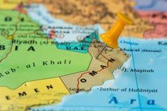 Map of Oman with a orange pushpin stuck Stock Photo
