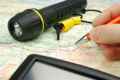 Map orientation. And navigation with pen and flashlight Royalty Free Stock Image