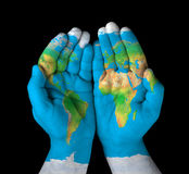 Map painted on hands Royalty Free Stock Photography
