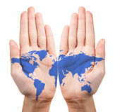 Map painted on the open hands. Isolated on white. Elements of this image furnished by NASA stock photos