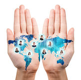 Map painted on the open hands Royalty Free Stock Images