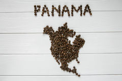 Map of the Panama made of roasted coffee beans laying on white wooden textured background. And space for text Stock Photography