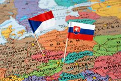Map and paper flags of Slovakia and Czech Republic. Neighboring countries in Central Europe royalty free stock photo