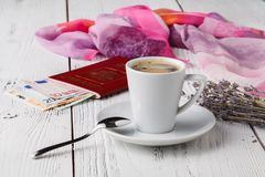 Map, passport, notebook and cup of coffee on wooden table, travel ideas Royalty Free Stock Image