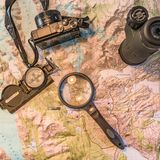 Map of Patagonia, compass, camera, monocular and loupe. For traveling Stock Photo