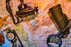 Map of Patagonia, compass, camera, monocular and loupe. For traveling Royalty Free Stock Photography