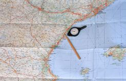 Map, pencil and curvimeter Royalty Free Stock Image