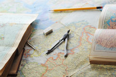 Map and pensil. Opened old atlas book on  map and pensil Stock Images