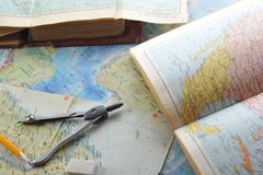 Map and pensil. Opened old atlas book on  map and pensil Royalty Free Stock Image