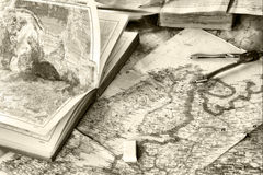 Map and pensil. Opened old atlas book on  map and pensil Stock Image