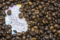 Map of Peru under a background of coffee beans. Geographical map of Peru covered by a background of roasted coffee beans. This nation is between the ten main royalty free stock photography