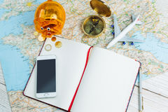 Map and piggy bank with savings money for traveling Stock Photo