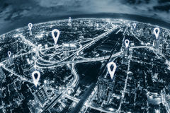 Map pin flat above blue tone city scape and network connection Stock Photos