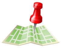 Map and pin. Icon of a tack or map pin about to go into a paper folded map Stock Image