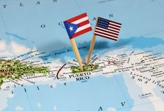 Map with pin point of Puerto Rico. With flag stock photos