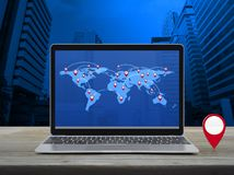 Map pointer navigation concept, Elements of this image furnished by NASA. Map pin location button with connection line and world map on modern laptop computer on royalty free stock photography