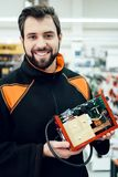 Map is posing with uninterruptible power supply, ups model in power tools store. Map is posing with uninterruptible power supply, ups model in aisle of power royalty free stock photo