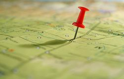 Map and pushpin. Geographical map and marked the place on her tack Royalty Free Stock Photo