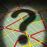Map Question. S concept as a city street topographic diagram with a cast shadow of a question mark as a business or life metaphor for direction uncertainty and Stock Photo