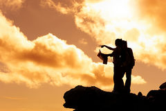 Map reading hiker at sunrise Royalty Free Stock Image