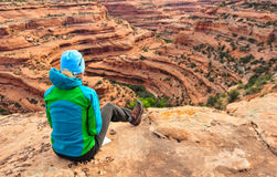 Map reading. Mature woman studying topo map on edge of canyon Stock Photography