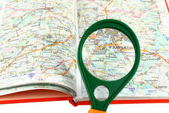 Map of roads and Magnifier Stock Photography