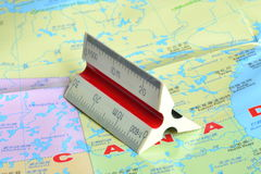 Map and ruler. This is a  proportional scale which is a tool for map design Stock Photo