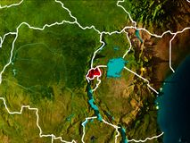 Map of Rwanda on Earth. Rwanda in the morning highlighted in red on planet Earth with visible border lines and city lights. 3D illustration. Elements of this Stock Photos