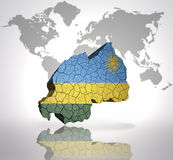 Map of rwanda. With rwandan Flag on a world map background Stock Images