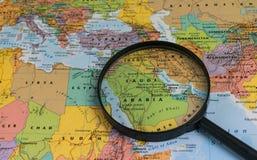 Map of Saudi Arabia through magnifying glass on a world map. Saudi Arabia map through magnifying glass on a world map Stock Photos
