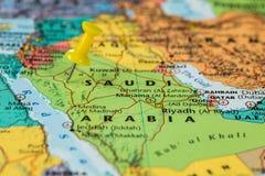 Map of Saudi Arabia with a yellow pushpin stuck Stock Photo