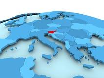 Slovenia on blue political globe. Map of Slovenia in red on blue political globe. 3D illustration Royalty Free Stock Photos