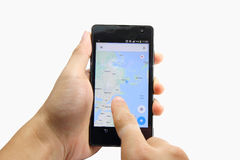 Map on smart phone. And finger slide on screen royalty free stock image